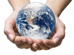 photo of hands holding earth