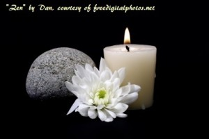 Relaxing image of candle and lotus flower